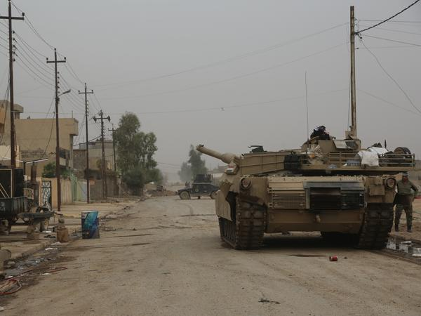 Iraqi forces patrol the Zahra neighborhood of Mosul on Nov. 16. Army and counter-terror forces have reached some parts of the city, but other forces are facing stiff ISIS resistance on the outskirts.