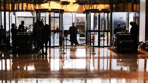 People walk into the lobby of Trump Tower in New York City on Nov. 14.