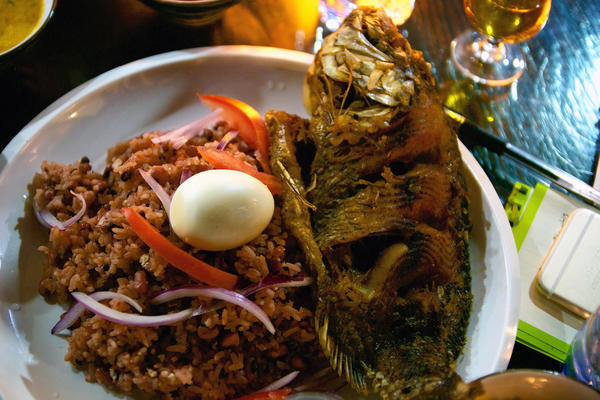 Fried tilapia with jollof rice, a West African specialty served at African Pot. The 3-year-old restaurant in Guangzhou, China, caters to the city's many African immigrants. Lately, it's seen a surge in Chinese customers, too.