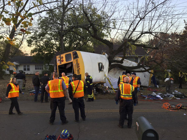 In this photo provided by the Chattanooga Fire Department via Chattanooga Times Free Press, Chattanooga Fire Department personnel work the scene of a fatal elementary school bus crash in Chattanooga, Tenn., on Monday.