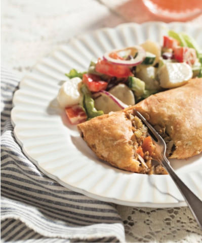"""<p>This savory handpie from Melissa Bahen's """"Scandinavian Gatherings"""" is good hot out of the oven but maybe even better after it's cooled a bit.</p>"""