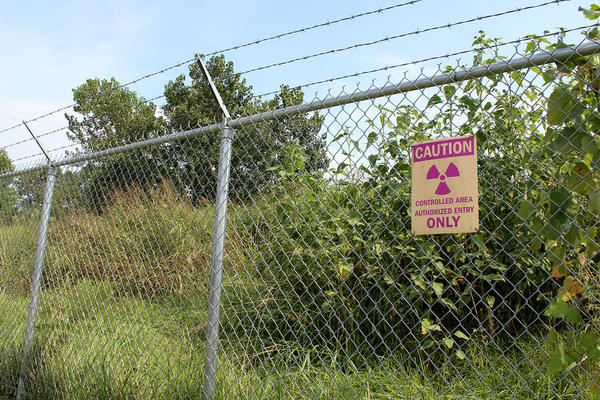 A cautionary sign at a fence around the West Lake Landfill Superfund site, which contains World War II-era nuclear waste.