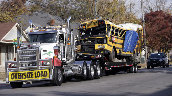 A school bus is carried away on Tuesday in Chattanooga, Tenn., from the site where it crashed on Monday. The bus driver, Johnthony Walker, 24, has been arrested on charges including vehicular homicide, reckless driving and reckless endangerment. The crash killed six elementary school students.