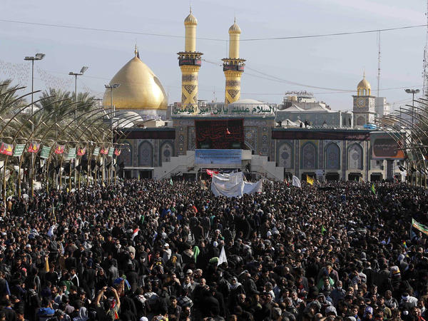 Shiite worshippers gather for Arbaeen in Karbala on Nov. 20. Dozens of Shiite pilgrims were targeted for attack Thursday after the holiday, which marks the end of the 40-day mourning period after the anniversary of the 7th century martyrdom of Imam Hussein, the Prophet Muhammad's grandson.