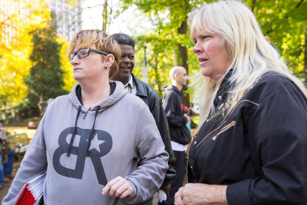 <p>An alternate juror with defendant Shawna Cox outside the federal courthouse in downtown Portland.</p>