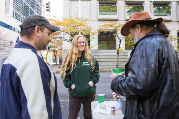 <p>Occupation supporters ate hotdogs and grits outside the federal courthouse in downtown Portland.</p>