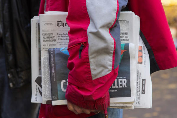 <p>Neil Wampler clutches a stack of newspapers the day after he and six others charged in the occupation of the Malheur National Wildlife Refuge were ruled not guilty of federal conspiracy charges.</p>