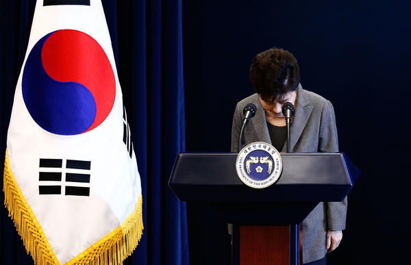 South Korean President Park Geun-Hye bows during an address to the nation, at the presidential Blue House in Seoul. South Korea's scandal-hit president said Tuesday she was willing leave office before the end of her term and would let parliament decide on her fate.