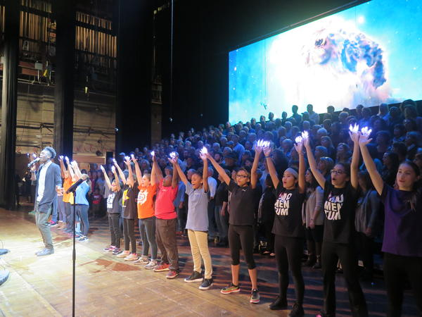 The student dance group Momentum practices with the Harmony Project choir at its tech rehearsal.