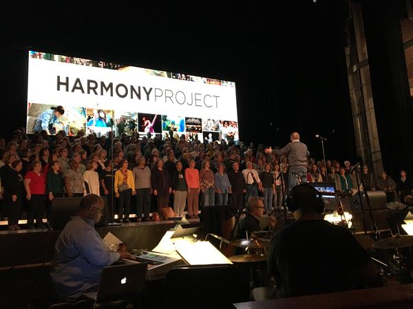 The Harmony Project choir is backed up by an orchestra.