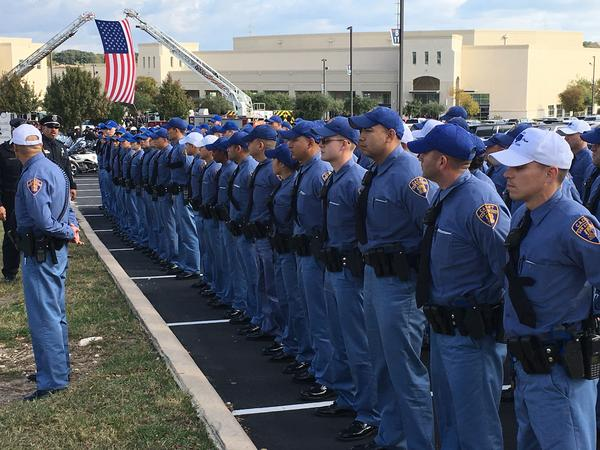 San Antonio Police Department cadets line up to pay their respects ahead of the funeral service for police Detective Benjamin Marconi outside Community Bible Church.