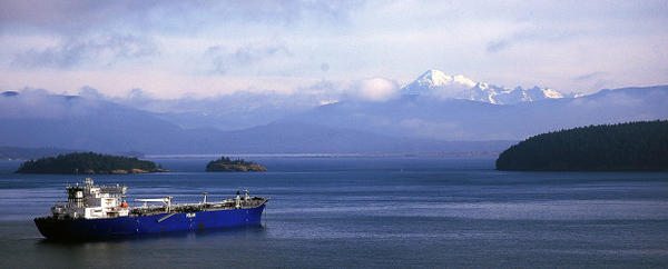 <p>An Endeavour-class oil tanker, which is operated by Polar Tankers, a subsidiary of Houston-based Conoco Phillips, is seen anchored in Padilla Bay, near Anacortes, Washington, with a view of Mount Baker in the distance on Nov. 19, 2005.</p>