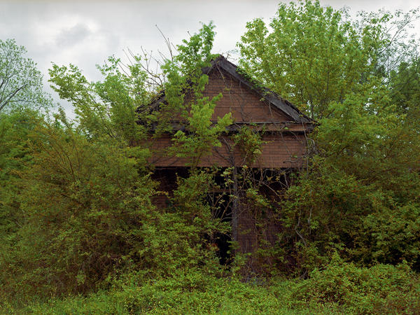 William Christenberry, Building with False Brick Siding, Warsaw, Alabama, 1991.