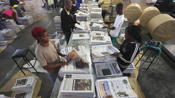 Zimbabwe's government has exercised control over most of the media. Here, workers sort out copies of <em>The Daily News</em>, one of the few independent newspapers. It was allowed to reopen in March 2011 after being shut down for years because it was critical of the government.