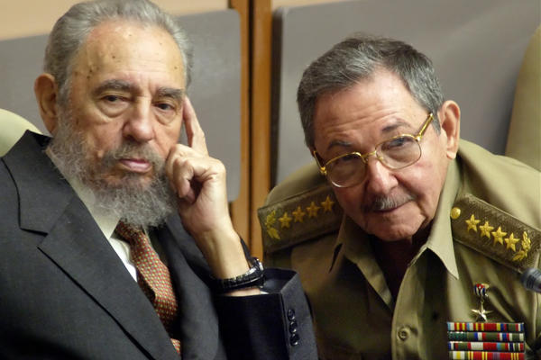 Castro and his brother Raul, the minister of defense, attend a Cuban Parliament session on July 1, 2004, in Havana. In 2006, Fidel Castro ceded power to his brother owing to poor health.
