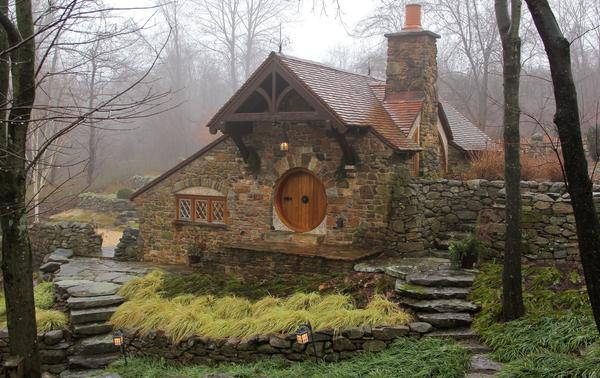 """Inspired by J.R.R. Tolkien's descriptions and drawings, <em>Lord of the Rings</em> fan Vince Donovan built a <a href=""""http://lotr.wikia.com/wiki/Hobbit-hole"""">hobbit-hole</a> to house his collection of Middle Earth memorabilia."""
