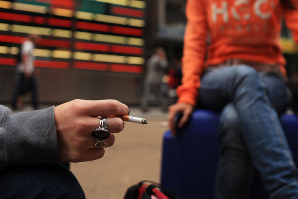 Women smoke in New York City's Times Square.