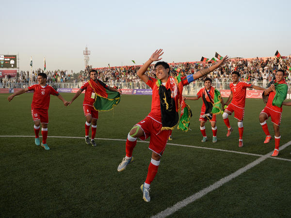 Afghan soccer players celebrate their 3-0 win against Pakistan on Aug. 20 in Kabul.