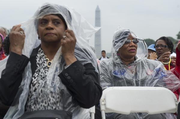 A steady rain fell during the event.