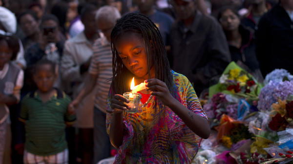 On Dec. 8, three days after Nelson Mandela's death, a girl in Johannesburg lights a candle in his memory. Poet Mbali Vilakazi has written an elegy for Mandela that asks the next generation of South Africans to continue his legacy.