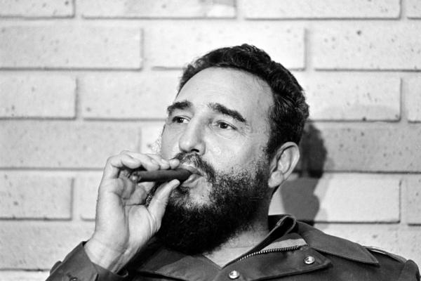 Castro smokes a cigar during his meeting with two U.S. senators, the first to visit Castro's Cuba, in Havana on Sept. 29, 1974.