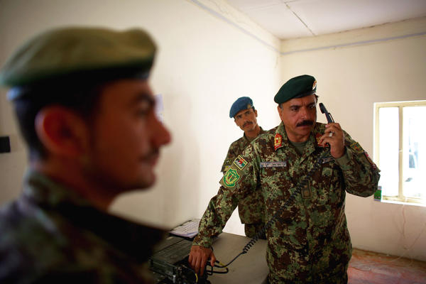 Brig. Gen. Akram Samme coordinates his men at Camp Eagle in the Shah Joy district of Zabul province in southern Afghanistan. He is a commander in the major operation against the Taliban that's currently under way.