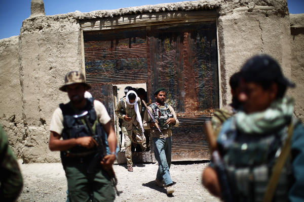 Afghan troops — joined this day by local police — patrol Tazir Abad.