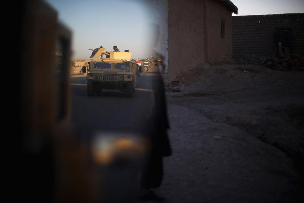 An convoy of Humvees moves down Highway One after a patrol in Shah Joy district.