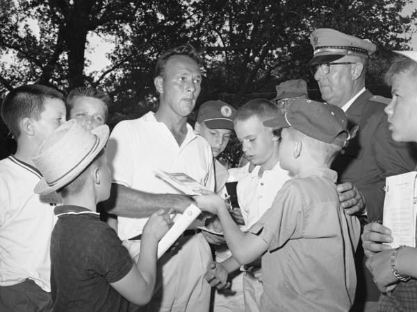 Palmer signs autographs at the Texas Open in 1962.