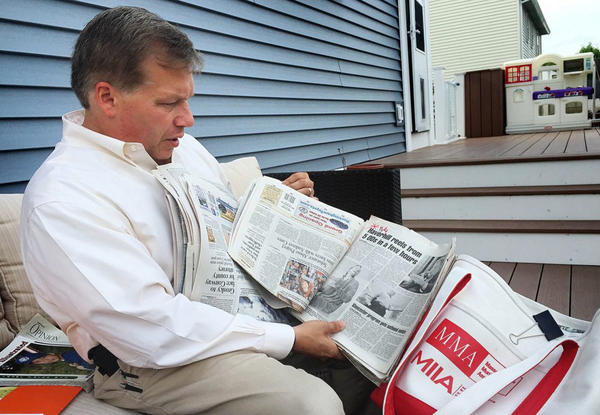 At his home in Haverhill, Mass., Colin LePage leafs through newspapers he shows to middle-schoolers to educate them about the dangers of drugs.