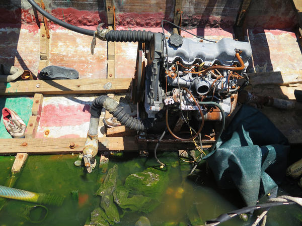 "The interior of a ""chug"" shows the engine along with sneakers and other debris from the migrants' trip."