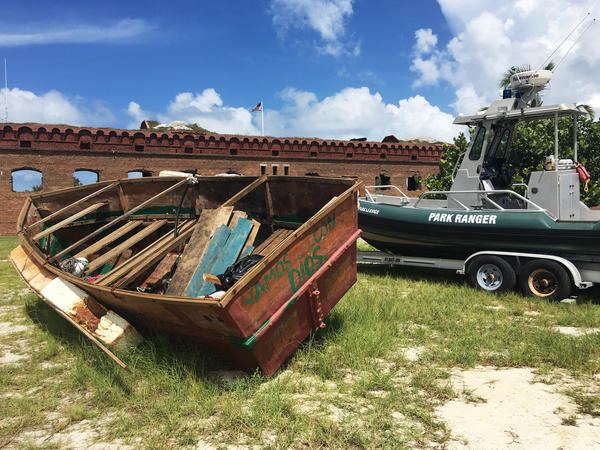 "A Cuban migrant vessel (left) known as a ""chug"" landed recently at Dry Tortugas National Park in Florida, 70 miles from Key West in the Gulf of Mexico. The vessels are homemade and often have engine trouble."