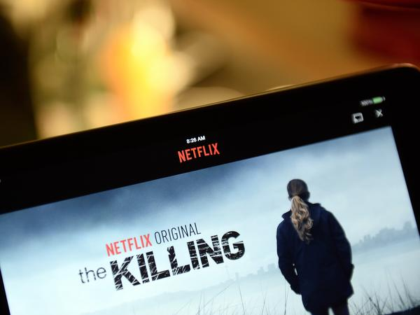 A screen shows a Netflix series, <em>The Killing.</em>
