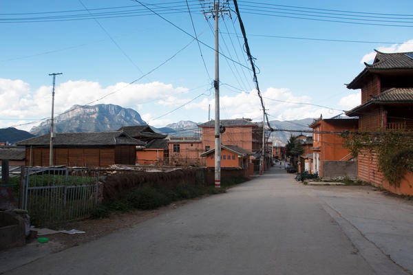A street leads through Luoshui Village toward Lugu Lake.