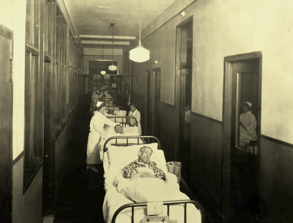 During the 1918-19 influenza pandemic, which killed upwards of 50 million people worldwide, patients at Bellevue slept in corridors, closets, and on beds of straw on the floors. No one was turned away.