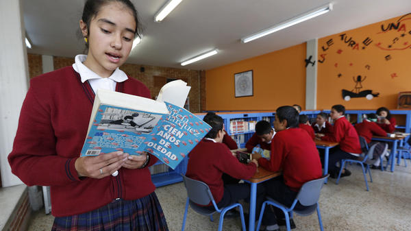 A student reads aloud from Gabriel García Márquez's <em>One Hundred Years of Solitude</em>, or <em>Cien Años de Soledad</em>, in Bogota, Colombia.