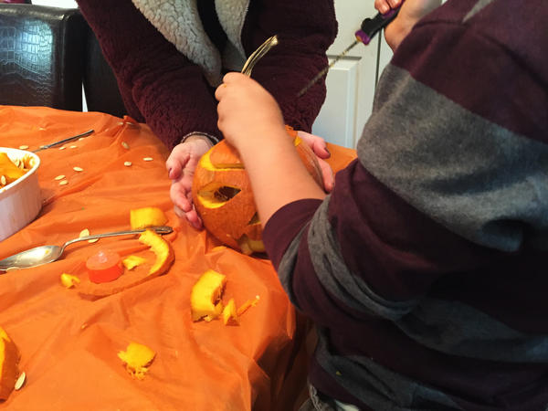 The family carves jack-o-lanterns for the first time.