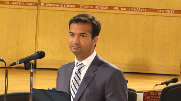 Republican Rep. Carlos Curbelo prepares to speak at a Miami-Dade County school board meeting. Curbelo began his political career on the school board.