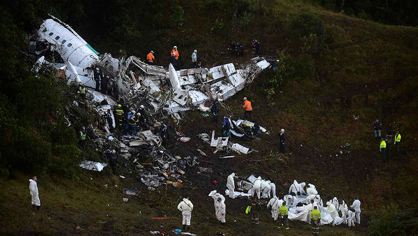 Rescuers search for survivors from the wreckage of the LAMIA airlines charter plane carrying members of the Chapecoense Real football team. The plane crashed in the mountains in Colombia late Monday, killing scores of people and leaving only a handful of survivors, officials said.
