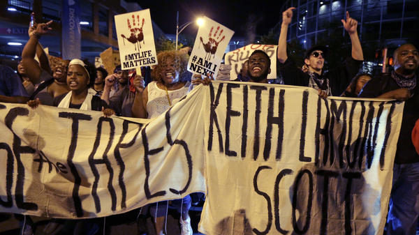 "People march in Charlotte, N.C., on Sept. 23 to protest the fatal police shooting of Keith Lamont Scott. The Mecklenburg County district attorney said Wednesday he was ""entirely convinced"" that the officer who shot Scott ""was lawful in using deadly force."""