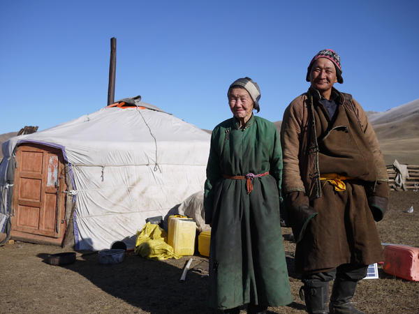 "Nomadic herders Lkhagvajav Bish, 90, and her son, Tsahiur Rentsenkhorloo, stand outside their ger in northeastern Mongolia. ""All I can do is watch my grassland disappear,"" says Bish."