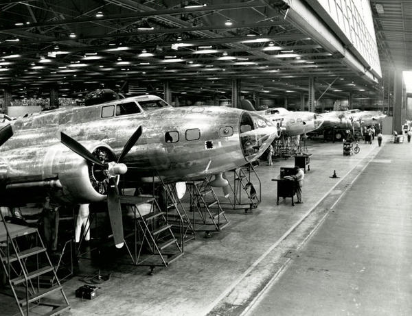 <p>A row of B-17 bombers being assembled by Boeing workers at a Seattle plant during World War II.</p>