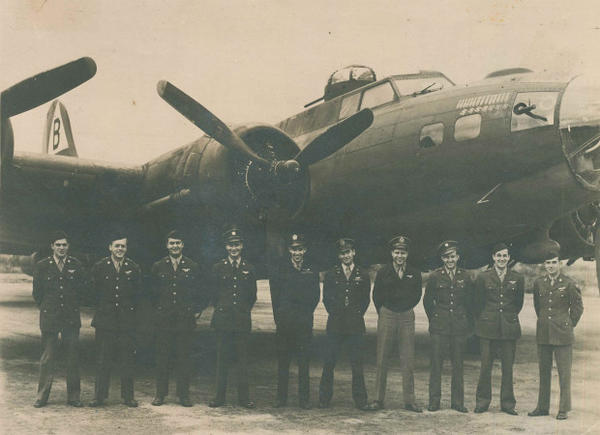 """<p>Joe Ahearn, Sr. stands third from left in front of """"Ready Teddy,"""" a B-17 that was built in Seattle. Of the 210 men in the 92nd Bombardment group, only 15 survived.</p>"""
