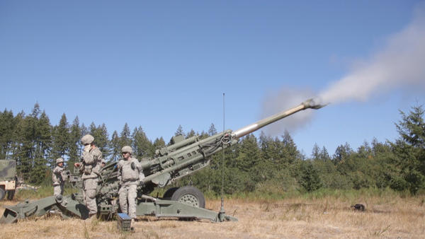 <p>Soldiers at JBLM practice shooting a howitzer, which fires shells a distance of six miles</p>