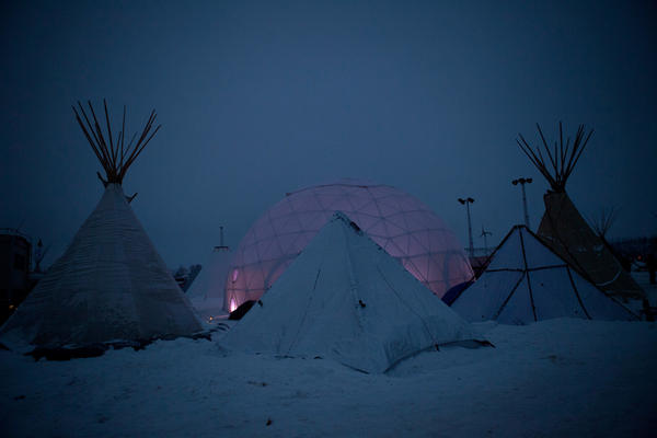 A geodesic dome, which was donated in October, now serves as a community gathering space. It is one of many structures that have been erected in the camp to prepare for the long winter ahead.