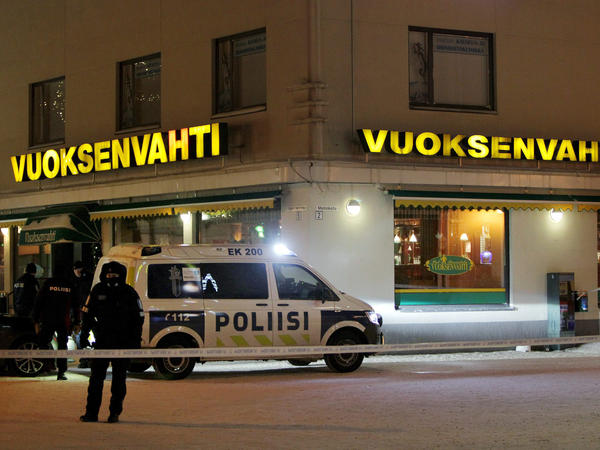 Police guard the area where three women were killed in a shooting incident outside of a restaurant in Imatra, Finland after midnight, Sunday.