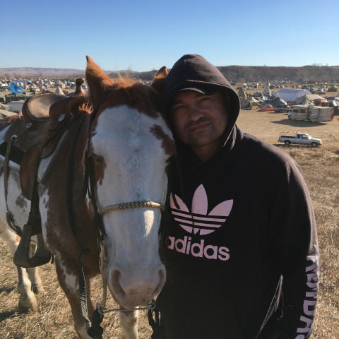 <p>Ace Baker is a member of the Standing Rock Sioux who lives with his family on the Swinomish Reservation near La Conner, Washington. He is pictured here in November with his horse Hidalgo at a camp where Dakota Access Pipeline protesters were staying.</p>
