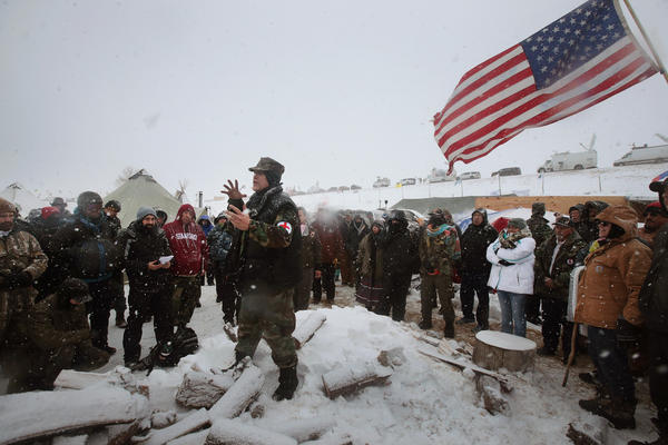 Military veterans are briefed on their role at Oceti Sakowin Camp and on cold-weather safety on Monday. Over the weekend, a group of veterans joined activists who have been trying to halt the construction of the Dakota Access Pipeline.