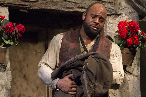 "Ryan Speedo Green as Colline in Puccini's ""La Bohème."" (Courtesy Marty Sohl/Metropolitan Opera)"