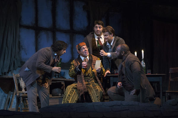 Rodion Pogossov as Schaunard, Philip Cokorinos as Benoit, David Bizic as Marcello, Dmytro Popov as Rodolfo and Ryan Speedo Green as Colline in Puccini's La Bohème. (Courtesy Marty Sohl/Metropolitan Opera)